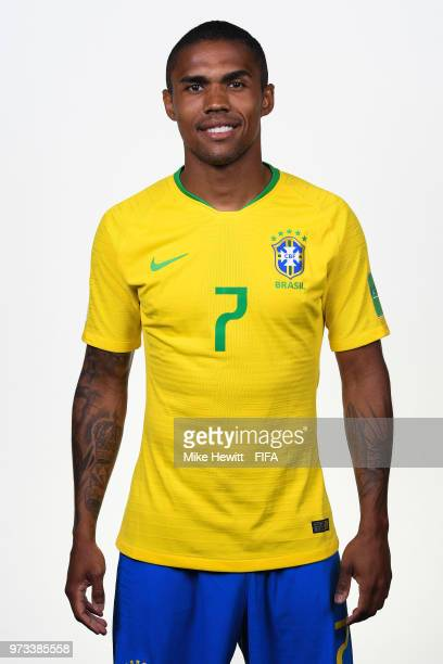 Douglas Costa of Brazil poses for a portrait during the official FIFA World Cup 2018 portrait session at the Brazil Team Camp on June 12 2018 in...