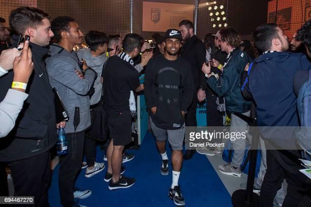 Douglas Costa of Brazil walks amongst fans during the Nike 'No Turning Back' Fan Meet Greet at Hangar 85 on June 10 2017 in Melbourne Australia