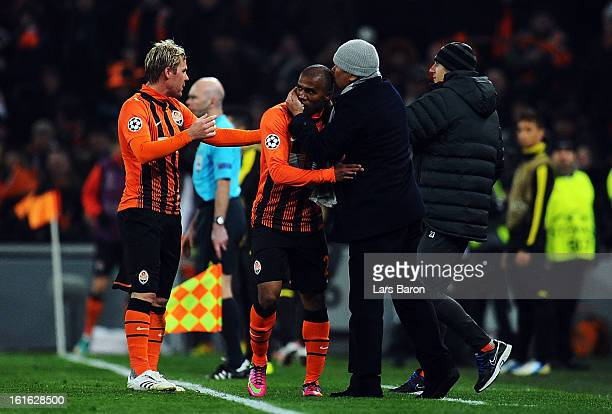 Douglas Costa of Donetsk celebrates with head coach Mircea Lucescu after scoring his teams second goal during the UEFA Champions League Round of 16...