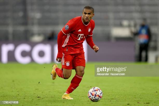 Douglas Costa of FC Bayern München runs with the ball during the UEFA Champions League Group A stage match between FC Bayern Muenchen and Lokomotiv...