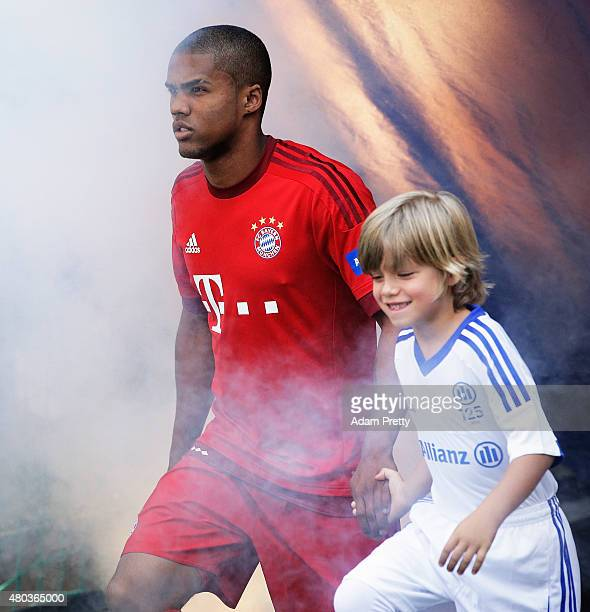 Douglas Costa of FC Bayern Muenchen is introduce to the fans on Season Opening Day at at Allianz Arena on July 11 2015 in Munich Germany