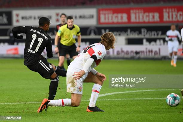 Douglas Costa of FC Bayern Munich scores his team's third goal during the Bundesliga match between VfB Stuttgart and FC Bayern Muenchen at...