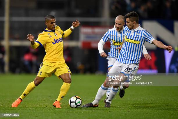 Douglas Costa of Juventus and Alberto Grassi of Spal during the serie A match between Spal and Juventus at Stadio Paolo Mazza on March 17 2018 in...
