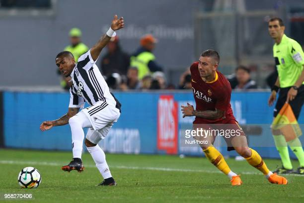 Douglas Costa of Juventus and Aleksandar Kolarov of Roma at Olimpico Stadium in Rome Italy on May 13 2018 during Serie A match between AS Roma and...
