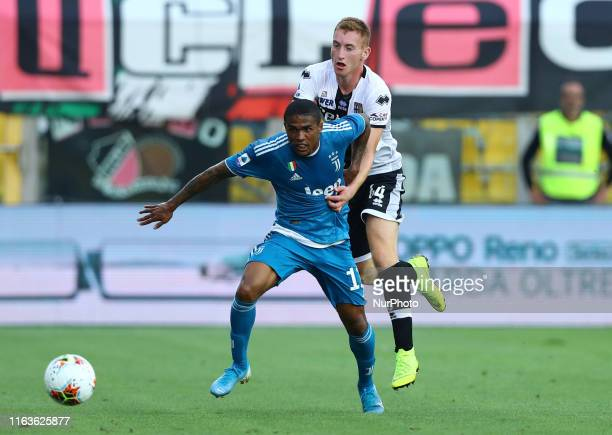Douglas Costa of Juventus and Dejan Kulusevski of Parma during the Serie A match Parma v Juventus at the Tardini Stadium in Parma Italy on August 24...