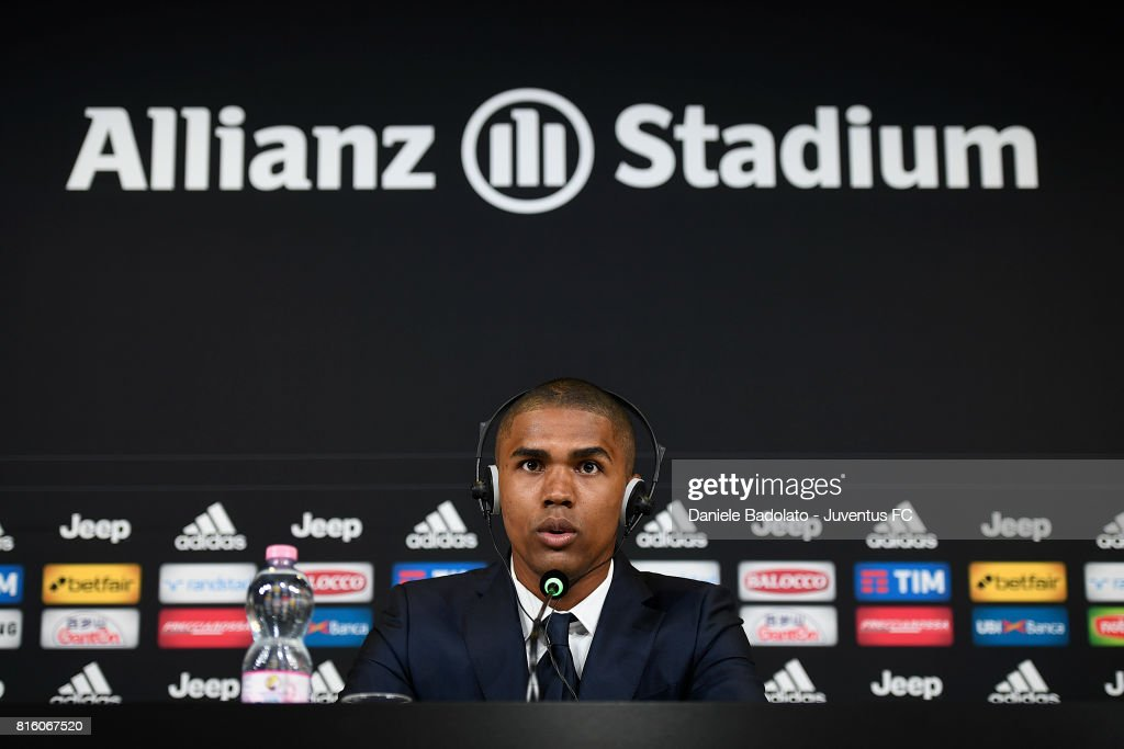 Douglas Costa of Juventus attends a press conference on July 17, 2017 in Turin, Italy.