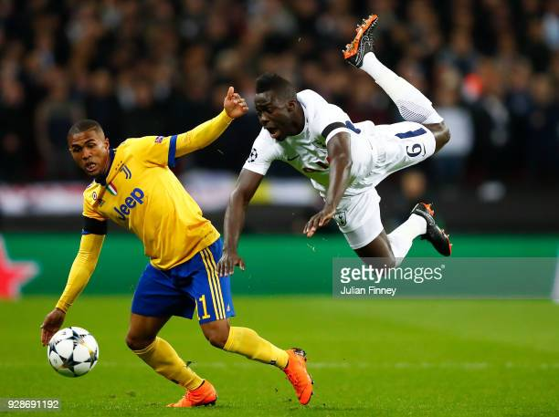 Douglas Costa of Juventus battle for the balls with Davinson Sanchez of Tottenham Hotspur during the UEFA Champions League Round of 16 Second Leg...