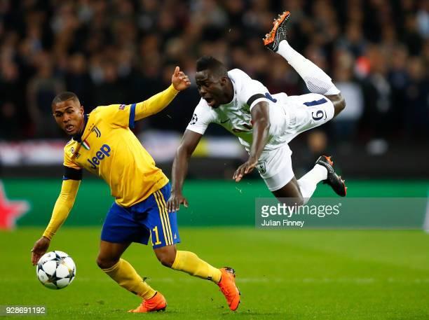 Douglas Costa of Juventus battle for the balls with Davinson Sanchez of Tottenham Hotspur during the UEFA Champions League Round of 16 Second Leg...