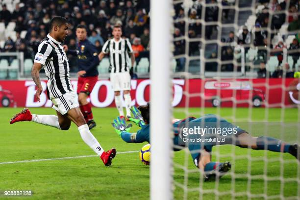 Douglas Costa of Juventus beats Mattia Perin of Genoa CFC to score the opening goal during the Serie A match between Juventus and Genoa CFC at...