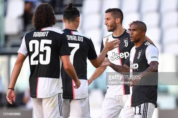 Douglas Costa of Juventus celebrates a goal with team mates during the Serie A match between Juventus and Torino FC at Allianz Stadium on July 4 2020...