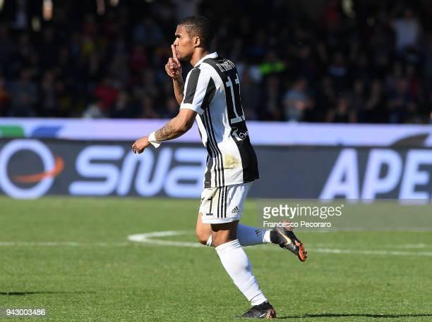 Douglas Costa of Juventus celebrates after scoring the 24 goal during the serie A match between Benevento Calcio and Juventus at Stadio Ciro Vigorito...