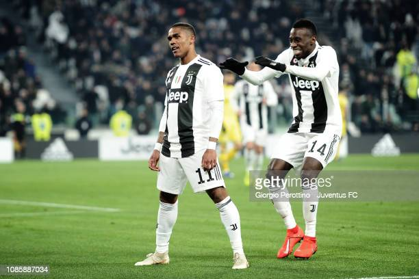 Douglas Costa of Juventus celebrates his opening goal with teammate Blaise Matuidi during the Serie A match between Juventus and Chievo at Allianz...