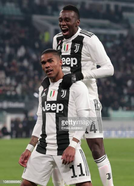 Douglas Costa of Juventus celebrates with his teammate Blaise Matuidi after scoring the opening goal during the Serie A match between Juventus and...