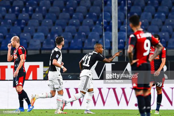 Douglas Costa of Juventus celebrates with his teammates after scoring a goal during the Serie A match between Genoa CFC and Juventus FC at Stadio...