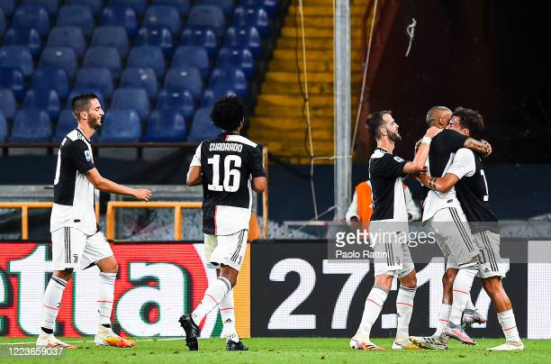 Douglas Costa of Juventus celebrates with his teammates Morale Pjanic and Paulo Dybala after scoring a goal during the Serie A match between Genoa...