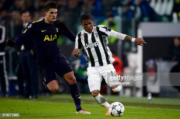 Douglas Costa of Juventus FC competes for the ball with Erik Lamela of Tottenham Hotspur FC during the UEFA Champions League Round of 16 First Leg...