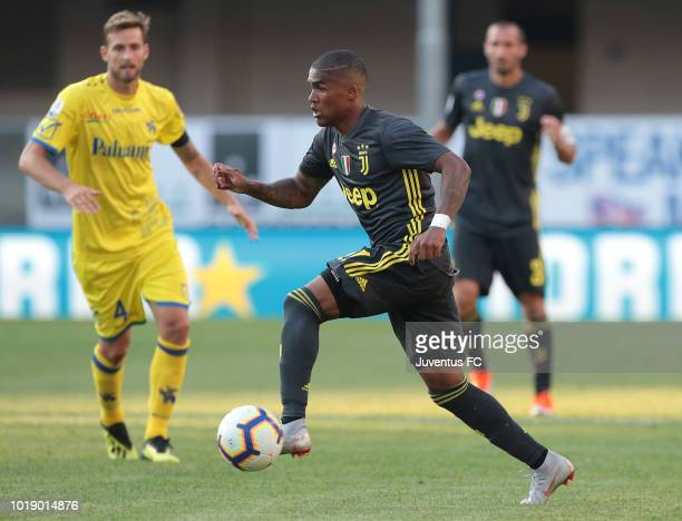 Douglas Costa of Juventus FC in action during the serie A match between Chievo Verona and Juventus at Stadio Marc'Antonio Bentegodi on August 18 2018...