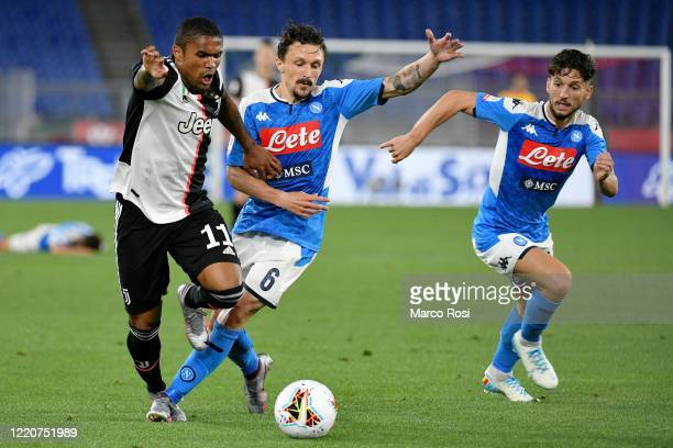 Douglas Costa of Juventus fights for the ball with Mario Rui of SSC Napoli during the Coppa Italia Final match between Juventus and SSC Napoli at...