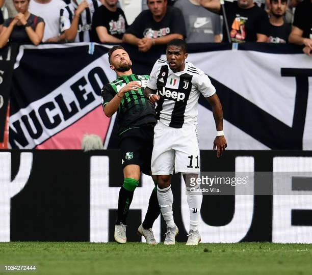 Douglas Costa of Juventus hits with an elbow Federico Di Francesco of Sassuolo during the serie A match between Juventus and US Sassuolo at Allianz...