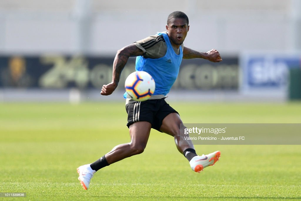 Douglas Costa of Juventus in action during a training session at JTC on August 5, 2018 in Turin, Italy.