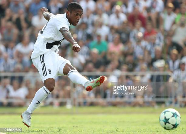 Douglas Costa of Juventus in action during the PreSeason Friendly match between Juventus and Juventus U19 on August 12 2018 in Villar Perosa Italy