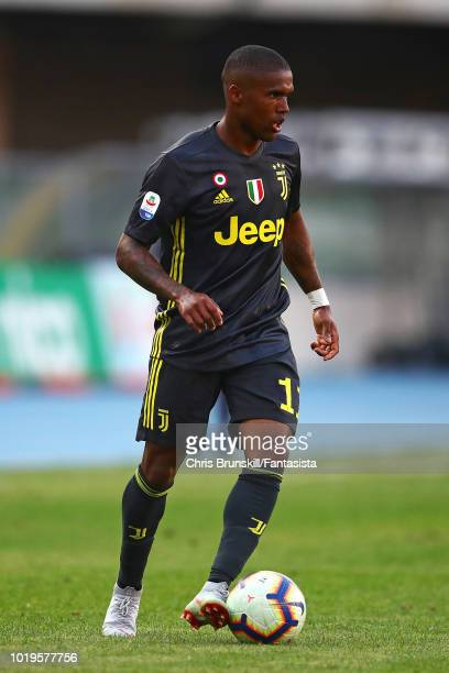Douglas Costa of Juventus in action during the Serie A match between Chievo Verona and Juventus at Stadio Marc'Antonio Bentegodi on August 18 2018 in...