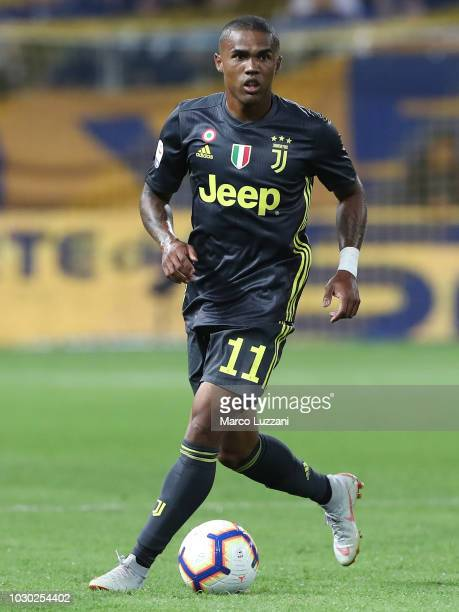 Douglas Costa of Juventus in action during the serie A match between Parma Calcio and Juventus at Stadio Ennio Tardini on September 1 2018 in Parma...
