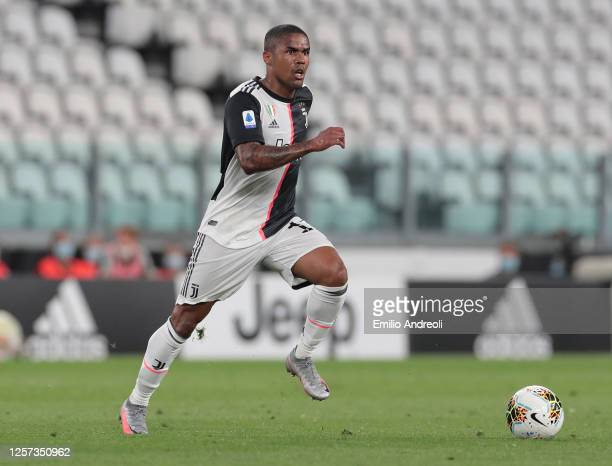 Douglas Costa of Juventus in action during the Serie A match between Juventus and SS Lazio at Allianz Stadium on July 20, 2020 in Turin, Italy.