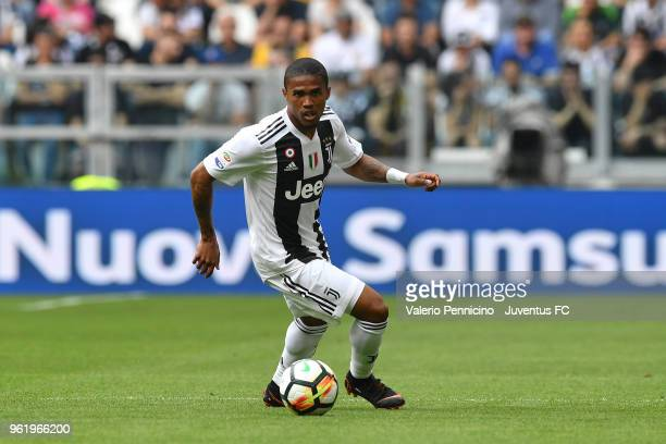 Douglas Costa of Juventus in action during the Serie A match between Juventus and Hellas Verona FC at Allianz Stadium on May 19 2018 in Turin Italy