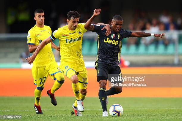 Douglas Costa of Juventus in action with Ivan Radovanovic of Chievo Verona during the Serie A match between Chievo Verona and Juventus at Stadio...