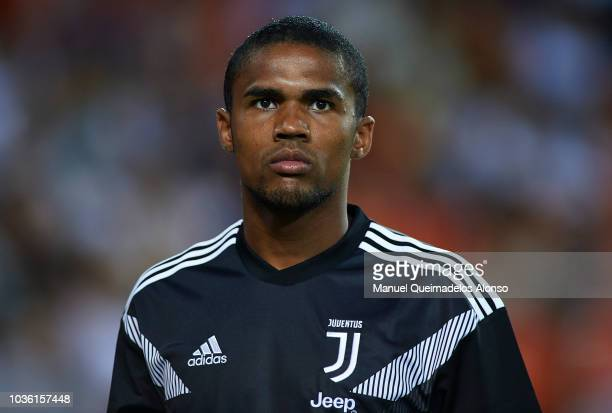Douglas Costa of Juventus looks on prior to the Group H match of the UEFA Champions League between Valencia and Juventus at Estadio Mestalla on...