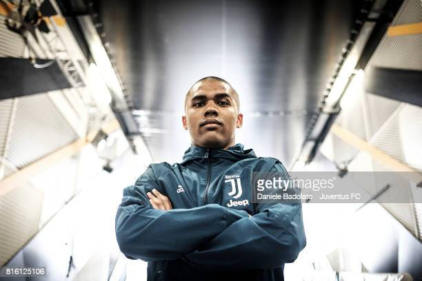 Douglas Costa of Juventus poses for a picture on July 17 2017 in Turin Italy