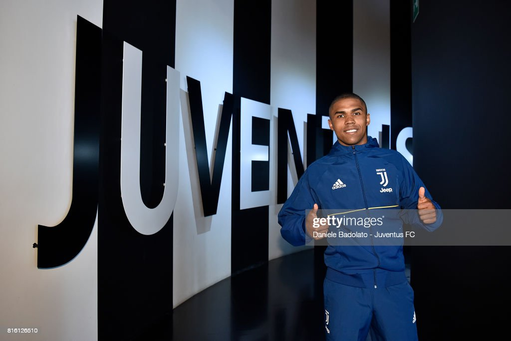 Douglas Costa of Juventus poses for a picture on July 17, 2017 in Turin, Italy.