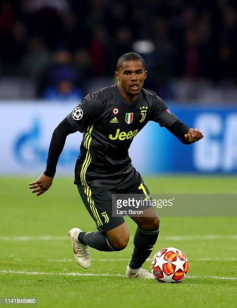 Douglas Costa of Juventus runs with the ball during the UEFA Champions League Quarter Final first leg match between Ajax and Juventus at Johan Cruyff...