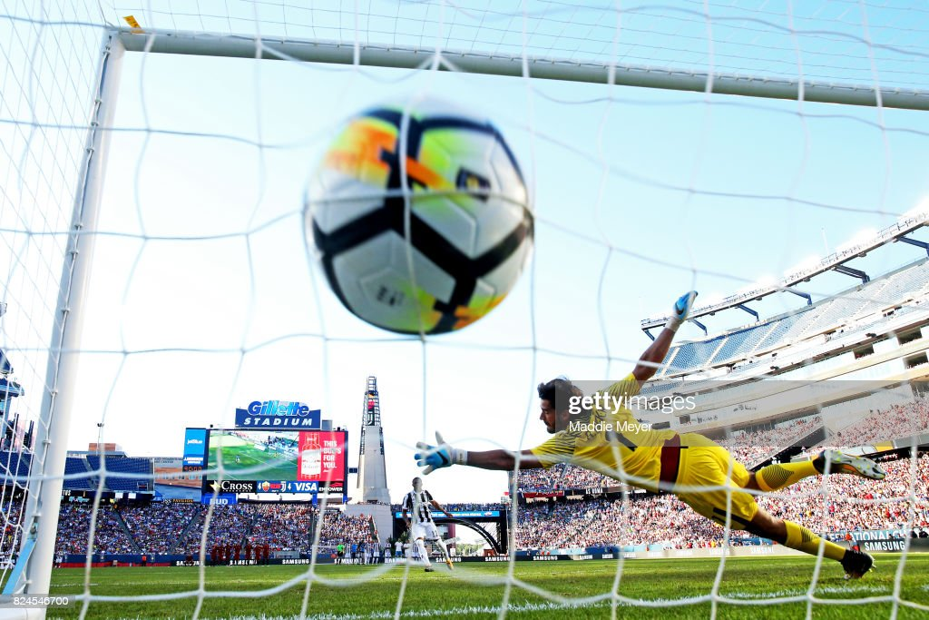 Douglas Costa #11 of Juventus scores the game winning penalty kick against Alisson Becker #1 of Roma during the International Champions Cup 2017 match at Gillette Stadium on July 30, 2017 in Foxboro, Massachusetts. Juventus defeat Roma 6-5 in penalties.
