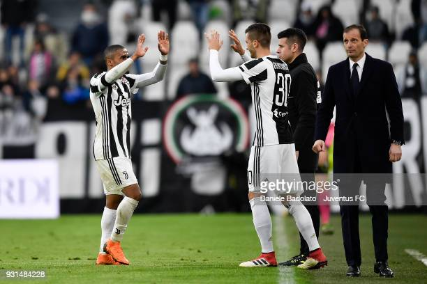 Douglas Costa of Juventus substituted by Rodrigo Bentancur during the serie A match between Juventus and Udinese Calcio on March 11 2018 in Turin...