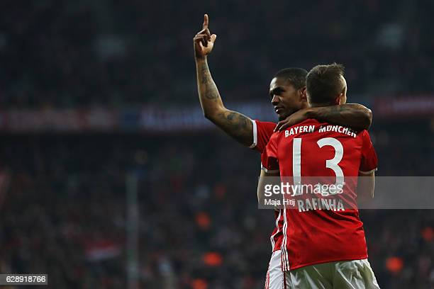 Douglas Costa of Muenchen celebrates his team's fifth goal with team mate Rafinha during the Bundesliga match between Bayern Muenchen and VfL...