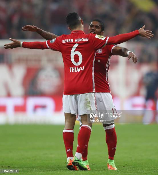 Douglas Costa of Muenchen celebrates his team's first goal with team mate Thiago Alcantara during the DFB Cup Round Of 16 match between Bayern...