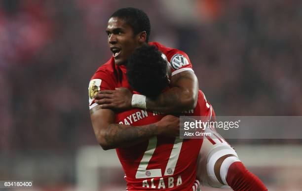 Douglas Costa of Muenchen celebrates his team's first goal with team mate David Alaba during the DFB Cup Round Of 16 match between Bayern Muenchen...