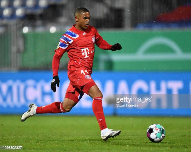 Douglas Costa of Muenchen in actionduring the DFB Cup second round match between Holstein Kiel and Bayern Muenchen at Wunderino Arena on January 13,...