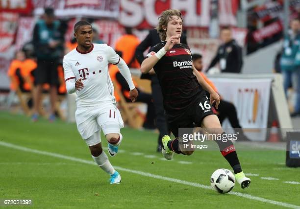 Douglas Costa of Munich and Tin Jedvaj of Leverkusen battle for the ball during the Bundesliga match between Bayer 04 Leverkusen and Bayern Muenchen...