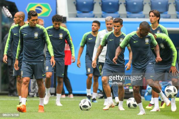 Douglas Costa of the Brazil national football team takes part in a training session at Saint Petersburg Stadium in Saint Petersburg on June 21 ahead...