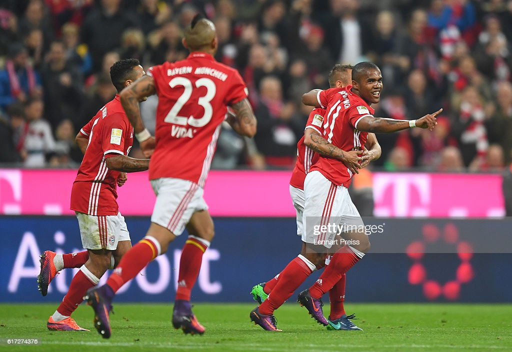 Douglas Costa (R-L), Rafinha, Arturo Vidal and Thiago Alcantara of FC Bayern Muenchen celebrate their team's second goal during the Bundesliga match between FC Bayern Muenchen and Borussia Moenchengladbach at Allianz Arena on October 22, 2016 in Munich, Germany.