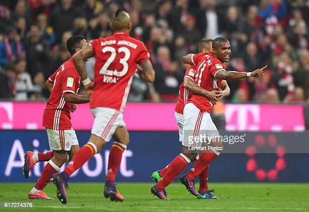 Douglas Costa Rafinha Arturo Vidal and Thiago Alcantara of FC Bayern Muenchen celebrate their team's second goal during the Bundesliga match between...
