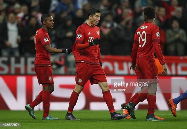 Douglas Costa Robert Lewandowski and Kingsley Coman of Bayern Muenchen celebrate Lewandowski's first goal during the Champions League group F match...
