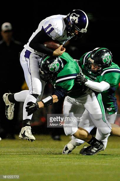 Douglas County quarterback Dylan Morris is tackled by Thunder Ridge linebacker Dylan Mandingo during a class 5A game at Shea Stadium in Highlands...
