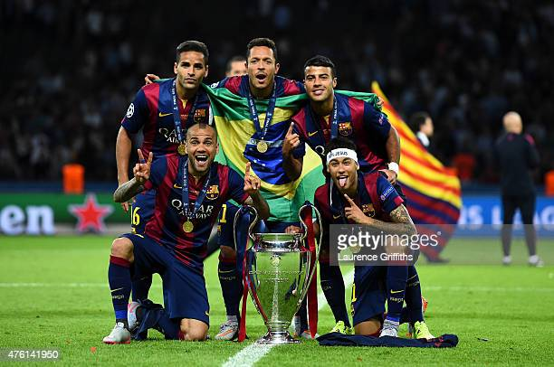 Douglas Daniel Alves Adriano Rafinha and Neymar of Barcelona celebrate with the trophy after the UEFA Champions League Final between Juventus and FC...