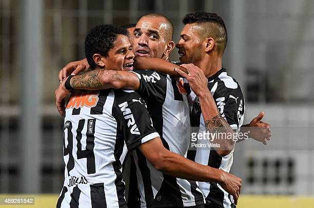Douglas Diego Tardelli and Carlos of Atletico MG celebrates a scored goal against Flamengo during a match between Atletico MG and Flamengo as part of...