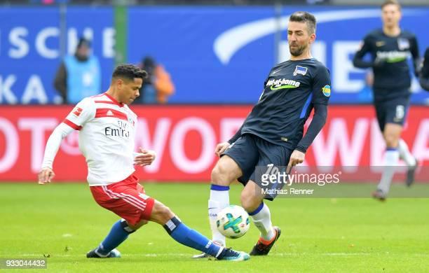 Douglas dos Santons Justino del Melo of Hamburger SV and Vedad Ibisevic of Hertha BSC during the Bundesliga game between Hamburger SV and Hertha BSC...