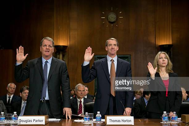 Douglas 'Doug' Parker chairman and chief executive officer of US Airways Group Inc left to right Thomas 'Tom' Horton chairman president and chief...
